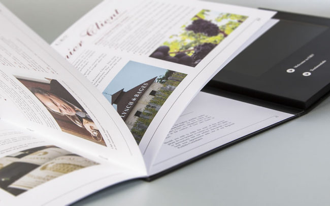 Hard back video brochure with 7 inch screen and additional booklet